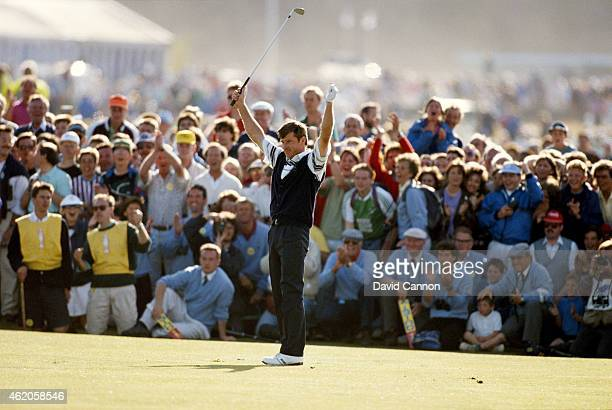 Nick Faldo of England raises his arms in triumph on the final green after securing a dominant victory during the 119th Open Championship played on...