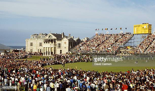 Nick Faldo of England raises his arms on the18th green after his win in the 119th Open Championship played on the Old Course at St Andrews on July 22...