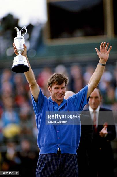 Nick Faldo of England raises the Claret Jug after his win during the 121st Open Championship at Muirfield Golf Club on July 19 1992 in Gullane...