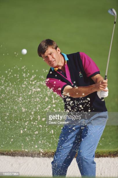 Nick Faldo of Great Britain chips out of a bunker during the the US Masters Golf Tournament on 9th April 1992 at the Augusta National Golf Club in...
