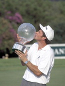 Nick Faldo of Great Britain kisses the trophy after winning the Million Dollar Challenge golf tournament held at the Sun City Golf Club in South...