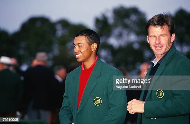 Nick Faldo Presents Green Jacket To Tiger Woods At Winners Ceremony During The 1997 Masters Tournament