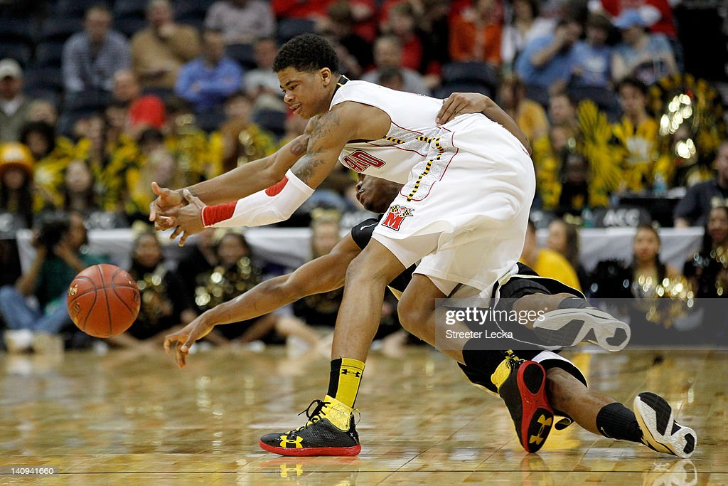 Nick Faust #5 of the Maryland Terrapins and C.J. Harris #11 of the Wake Forest Demon Deacons fight for a loose ball in the second half during their first round game of 2012 ACC Men's Basketball Conferene Tournament at Philips Arena on March 8, 2012 in Atlanta, Georgia.