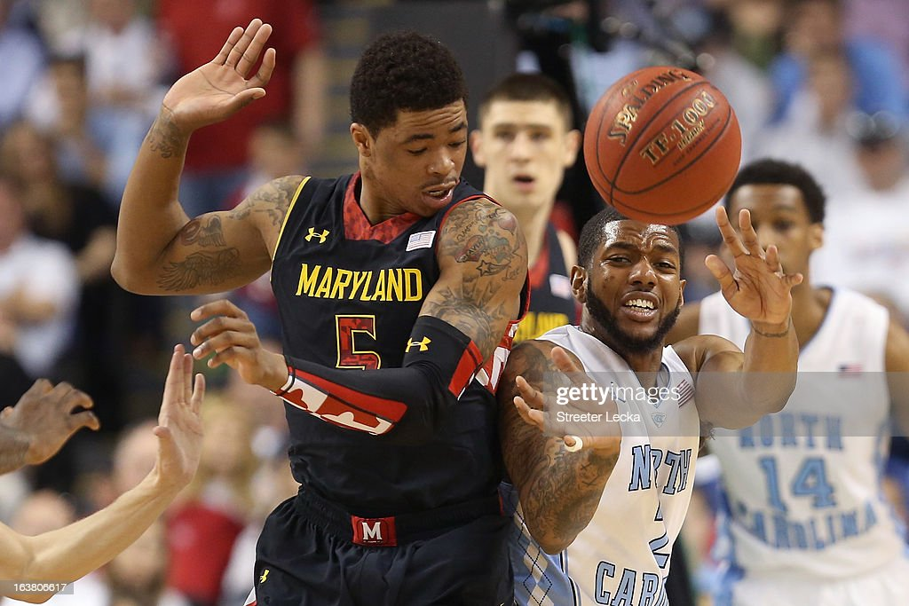 Nick Faust #5 of the Maryland Terrapins and Leslie McDonald #2 of the North Carolina Tar Heels battle for a loose ball in the first half during the men's ACC Tournament semifinals at Greensboro Coliseum on March 16, 2013 in Greensboro, North Carolina.