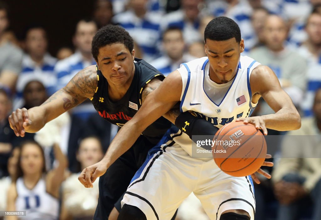 Nick Faust #5 of the Maryland Terrapins and <a gi-track='captionPersonalityLinkClicked' href=/galleries/search?phrase=Quinn+Cook&family=editorial&specificpeople=6753591 ng-click='$event.stopPropagation()'>Quinn Cook</a> #2 of the Duke Blue Devils battle for a loose ball during their game at Cameron Indoor Stadium on January 26, 2013 in Durham, North Carolina.