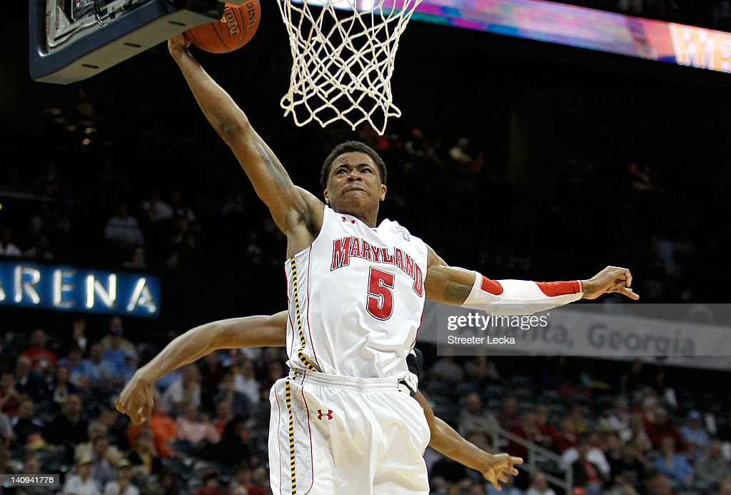 Nick Faust #5 of the Maryland Terrapins drives for a dunk past Travis McKie #30 of the Wake Forest Demon Deacons during their first round game of 2012 ACC Men's Basketball Conferene Tournament at Philips Arena on March 8, 2012 in Atlanta, Georgia.