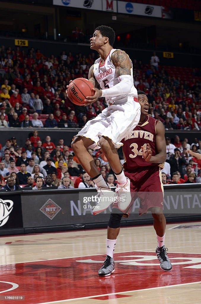 Nick Faust of the Maryland Terrapins drives to the hoop against the Denver Pioneers during the second round of the NIT Basketball Tournament at the...