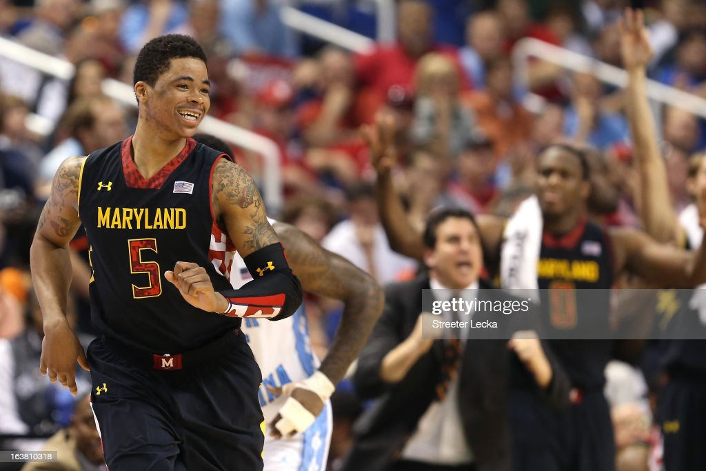 Nick Faust #5 of the Maryland Terrapins reacts in the second half after making a three-pointer while taking on the North Carolina Tar Heels during the men's ACC Tournament semifinals at Greensboro Coliseum on March 16, 2013 in Greensboro, North Carolina.