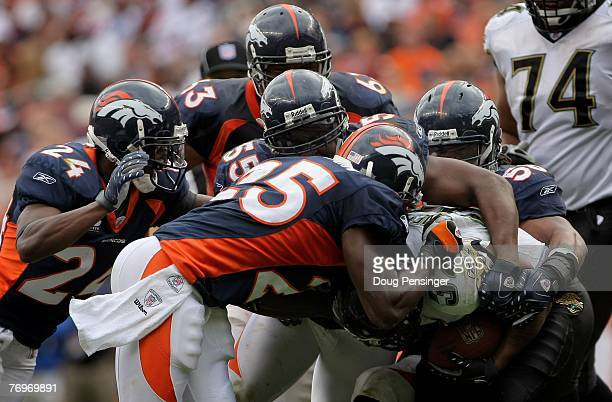 Nick Ferguson Nate Webster DJ Williams Champ Bailey and Amon Gordon of the Denver Broncos get in on the action as they make a stop on Maurice...