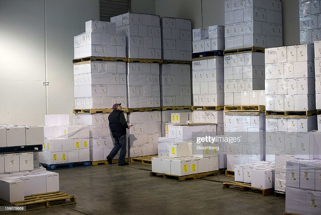 Nick Ferrante, owner of the Ferrante Winery, takes inventory of boxes of wine at the company's facility in Geneva, Ohio, U.S., on Friday, Jan. 4, 2013. Ice wine is a type of dessert wine produced from grapes that have been frozen while still on the vine, because the sugars and other dissolved solids do not freeze, but the water does, this allows a more concentrated grape must to be pressed. Photographer: Ty Wright/Bloomberg via Getty Images