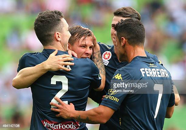 Nick Fitgerald of the Mariners is congratulated by team mates after scoring a goal during the round three ALeague match between Melbourne City FC and...