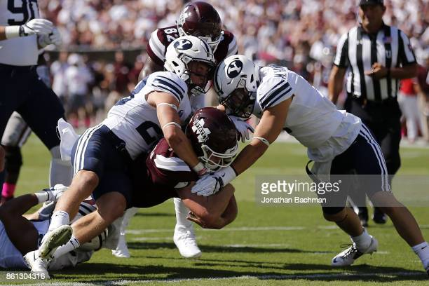 Nick Fitzgerald of the Mississippi State Bulldogs scores a touchdown during the first half of a game against the Brigham Young Cougars at Davis Wade...