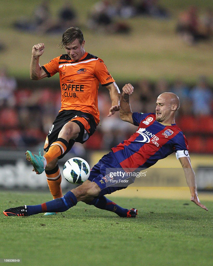 Nick Fitzgerald of the Roar and Ruben Zadkovich of the Jets contest the ball during the round 16 A-League match between the Newcastle Jets and the Brisbane Roar at Hunter Stadium on January 12, 2013 in Newcastle, Australia.