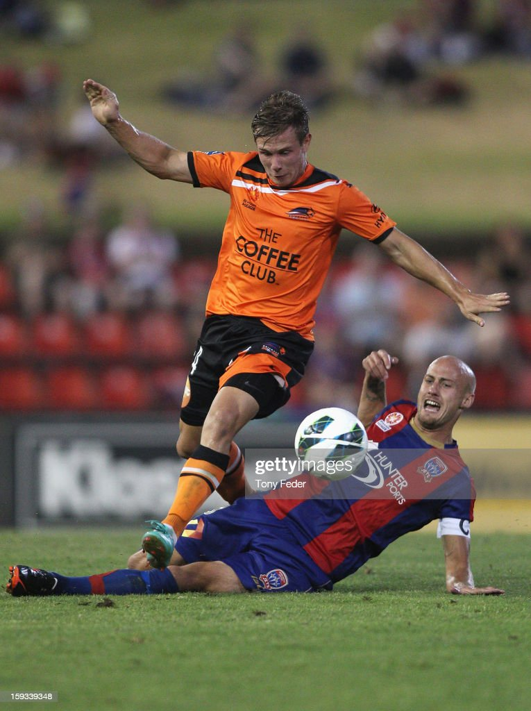 Nick Fitzgerald of the Roar contests the ball with Ruben Zadkovich of the Jets during the round 16 A-League match between the Newcastle Jets and the Brisbane Roar at Hunter Stadium on January 12, 2013 in Newcastle, Australia.