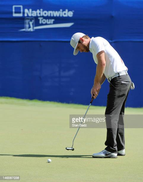 Nick Flanagan from Australia hits a putt on the 18th hole during the second playoff hole of the final round of the BMW Charity ProAm presented by...