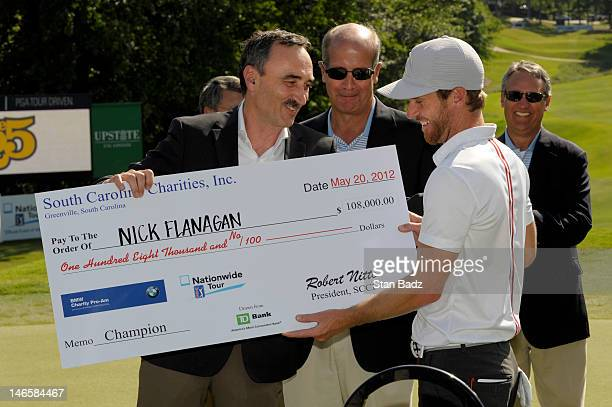 Nick Flanagan from Australia is presented the winner's check during the final round of the BMW Charity ProAm presented by SYNNEX Corporation at the...