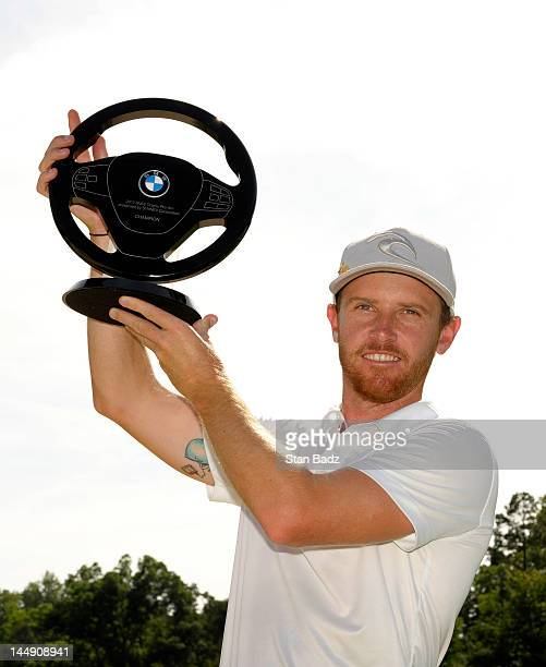 Nick Flanagan from Australia poses with the winner's trophy during the final round of the BMW Charity ProAm presented by SYNNEX Corporation at the...