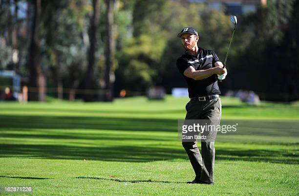 Nick Flanagan of Australia chips onto the 16th green during the first round of the Colombia Championship at Country Club de Bogota on February 28...