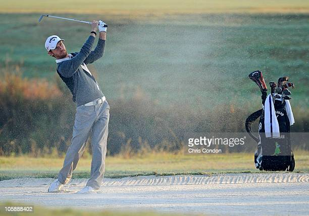 Nick Flanagan of Australia hits from a bunker on the first hole during the first round of the WinnDixie Jacksonville Open presented by Planters at...