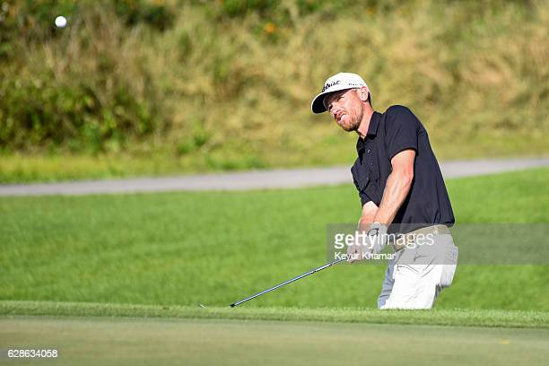 Nick Flanagan of Australia hits out of a greenside bunker on the 18th hole during the first round of Webcom Tour QSchool on the Crooked Cat Course at...