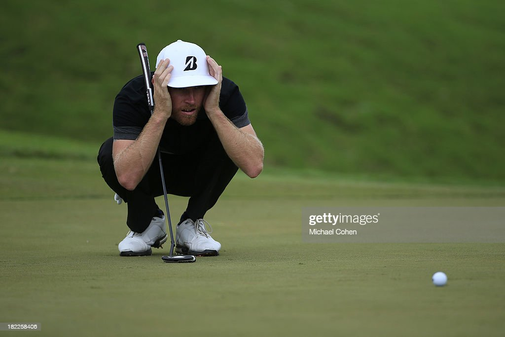<a gi-track='captionPersonalityLinkClicked' href=/galleries/search?phrase=Nick+Flanagan&family=editorial&specificpeople=240596 ng-click='$event.stopPropagation()'>Nick Flanagan</a> of Australia lines up a birdie putt on the third green during the third round of the Web.com Tour Championship held on the Dye's Valley Course at TPC Sawgrass on September 28, 2013 in Ponte Vedra Beach, Florida.