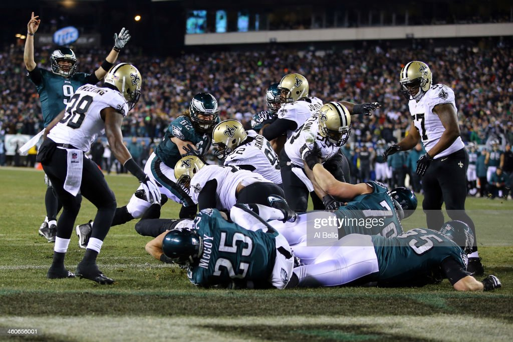 Nick Foles #9 celebrates as LeSean McCoy #25 of the Philadelphia Eagles scores a 1 yard touchdown in the third quarter against the New Orleans Saints during their NFC Wild Card Playoff game at Lincoln Financial Field on January 4, 2014 in Philadelphia, Pennsylvania.