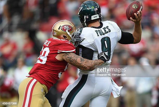 Nick Foles of the Philadelphia Eagles drops back to pass and gets pressure from Aaron Lynch of the San Francisco 49ers during the fourth quarter at...