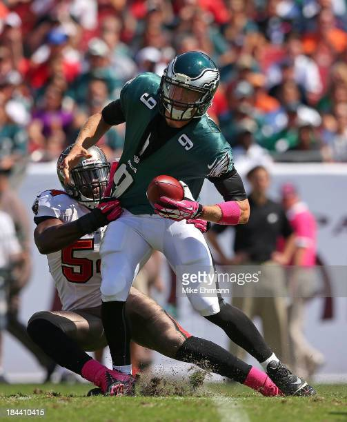 Nick Foles of the Philadelphia Eagles is sacked by Lavonte David of the Tampa Bay Buccaneers during a game at Raymond James Stadium on October 13...
