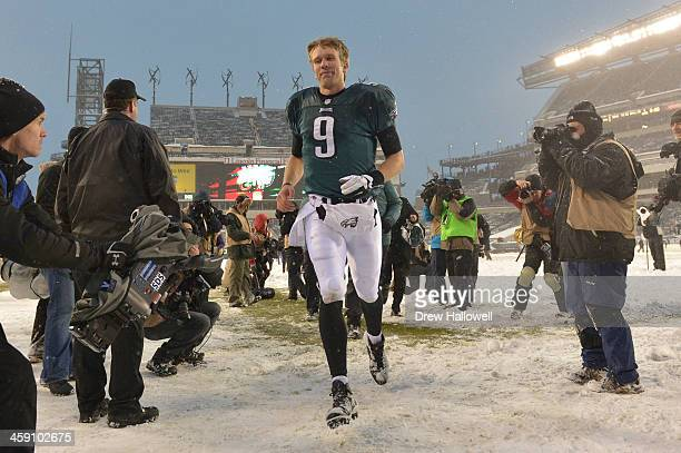 Nick Foles of the Philadelphia Eagles runs off the field after the game against the Detroit Lions at Lincoln Financial Field on December 8 2013 in...