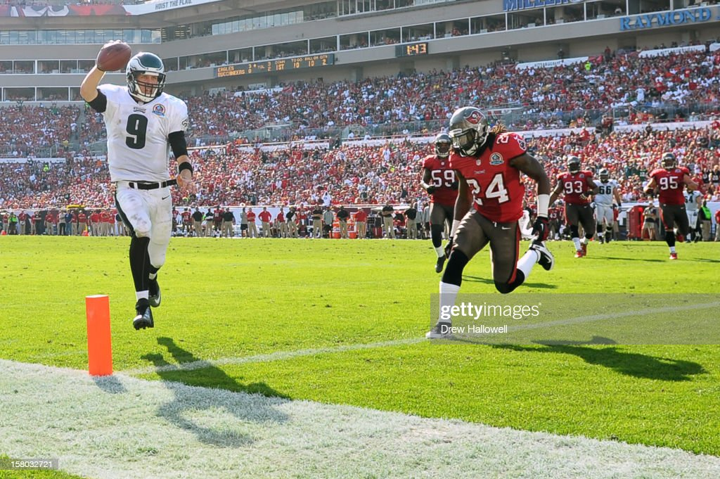 Nick Foles #9 of the Philadelphia Eagles rushes for a touchdown past Mark Barron #24 of the Tampa Bay Buccaneers at Raymond James Stadium on December 9, 2012 in Tampa, Florida. The Eagles won 23-21.