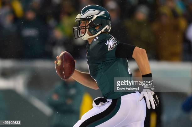 Nick Foles of the Philadelphia Eagles scrambles against the Detroit Lions at Lincoln Financial Field on December 8 2013 in Philadelphia Pennsylvania...