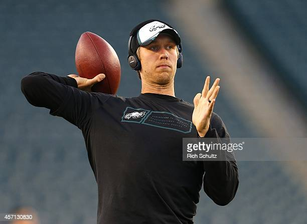 Nick Foles of the Philadelphia Eagles warms up before a game against the New York Giants at Lincoln Financial Field on October 12 2014 in...