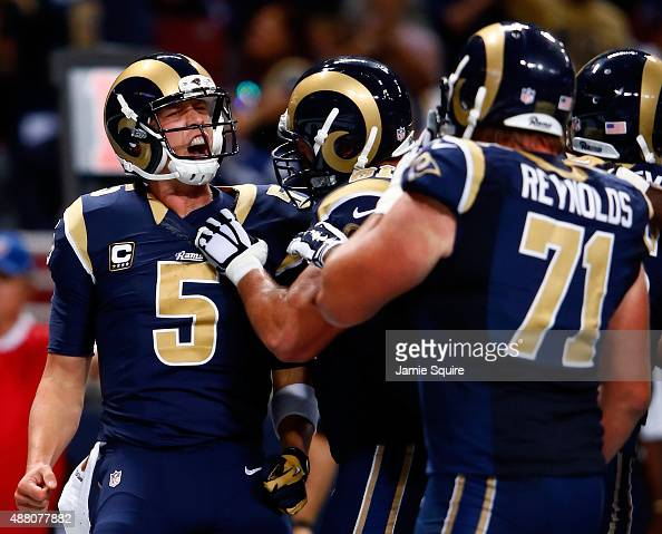 Nick Foles of the St Louis Rams celebrates a third quarter touchdown against the Seattle Seahawks at the Edward Jones Dome on September 13 2015 in St...
