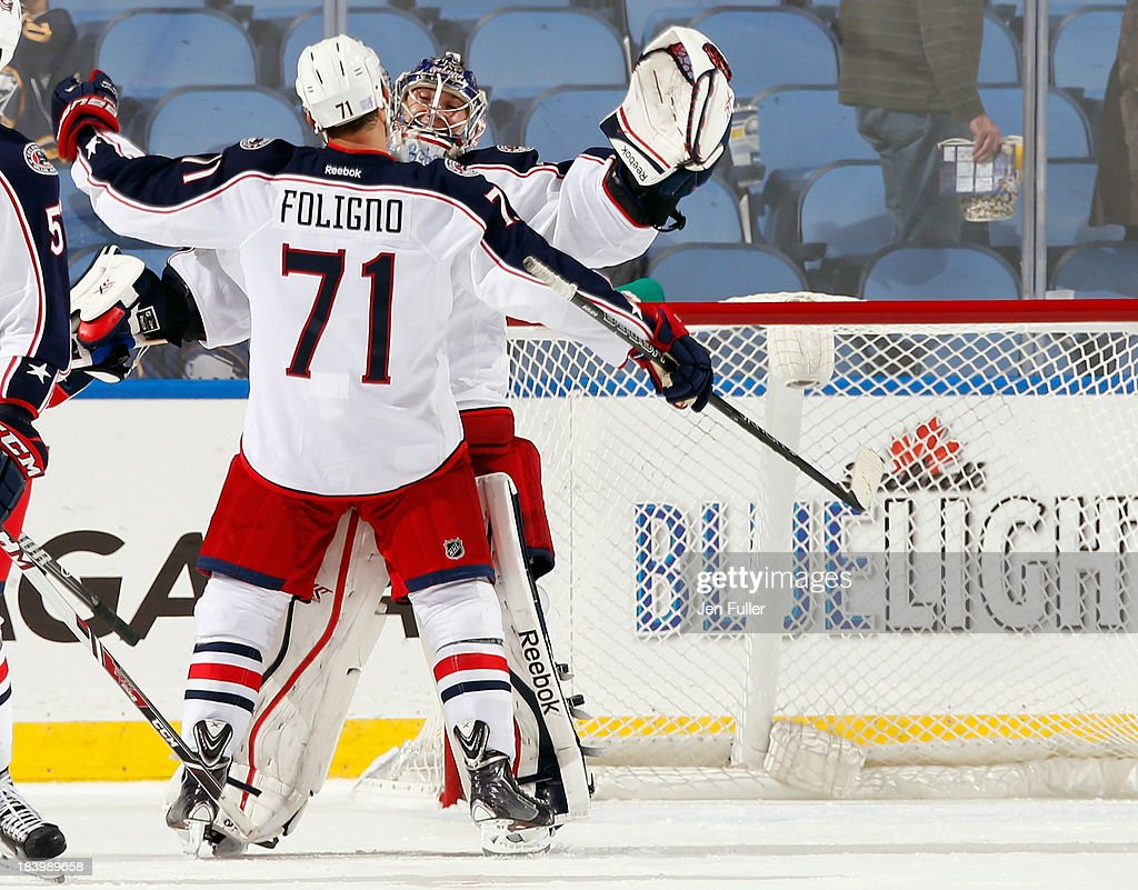<a gi-track='captionPersonalityLinkClicked' href=/galleries/search?phrase=Nick+Foligno&family=editorial&specificpeople=537821 ng-click='$event.stopPropagation()'>Nick Foligno</a> #71 and <a gi-track='captionPersonalityLinkClicked' href=/galleries/search?phrase=Sergei+Bobrovsky&family=editorial&specificpeople=4488556 ng-click='$event.stopPropagation()'>Sergei Bobrovsky</a> #72 of the Columbus Blue Jackets celebrate a 4-1 victory over the Buffalo Sabres at First Niagara Center on October 10, 2013 in Buffalo, New York.