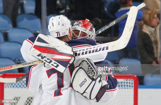 Nick Foligno and Sergei Bobrovsky of the Columbus Blue Jackets celebrate after an NHL game against the Buffalo Sabres on November 20 2017 at KeyBank...