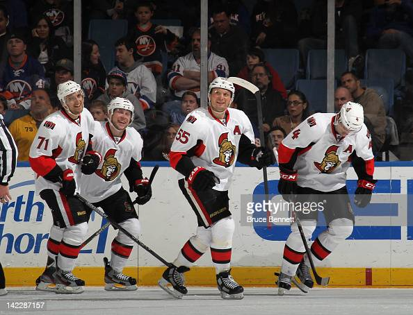 Nick Foligno Bobby Butler Sergei Gonchar and Chris Phillips of the Ottawa Senators skate to the bench following Foligno's second period goal against...