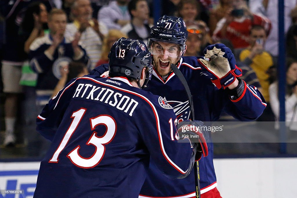 <a gi-track='captionPersonalityLinkClicked' href=/galleries/search?phrase=Nick+Foligno&family=editorial&specificpeople=537821 ng-click='$event.stopPropagation()'>Nick Foligno</a> #71 of the Columbus Blue Jackets and <a gi-track='captionPersonalityLinkClicked' href=/galleries/search?phrase=Cam+Atkinson&family=editorial&specificpeople=6270272 ng-click='$event.stopPropagation()'>Cam Atkinson</a> #13 of the Columbus Blue Jackets congratulate each other after defeating the Nashville Predators 3-1 on April 27, 2013 at Nationwide Arena in Columbus, Ohio.