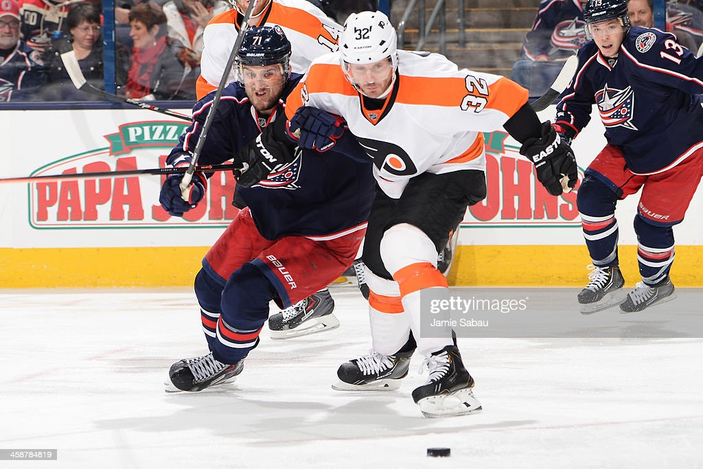 <a gi-track='captionPersonalityLinkClicked' href=/galleries/search?phrase=Nick+Foligno&family=editorial&specificpeople=537821 ng-click='$event.stopPropagation()'>Nick Foligno</a> #71 of the Columbus Blue Jackets and <a gi-track='captionPersonalityLinkClicked' href=/galleries/search?phrase=Mark+Streit&family=editorial&specificpeople=636976 ng-click='$event.stopPropagation()'>Mark Streit</a> #32 of the Philadelphia Flyers battle for a loose puck during the third period on December 21, 2013 at Nationwide Arena in Columbus, Ohio. Columbus defeated Philadelphia 6-3.