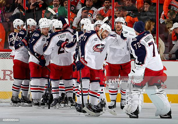 Nick Foligno of the Columbus Blue Jackets and the rest of his teammates celebrate the win over the Philadelphia Flyers on November 14 2014 at the...