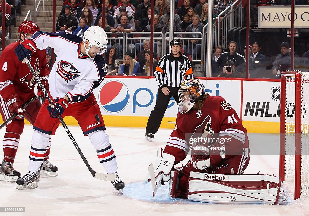 Nick Foligno #71 of the Columbus Blue Jackets attempts to control the puck for a shot on goaltender Mike Smith #41 of the Phoenix Coyotes during the first period of the NHL game at Jobing.com Arena on January 23, 2013 in Glendale, Arizona.