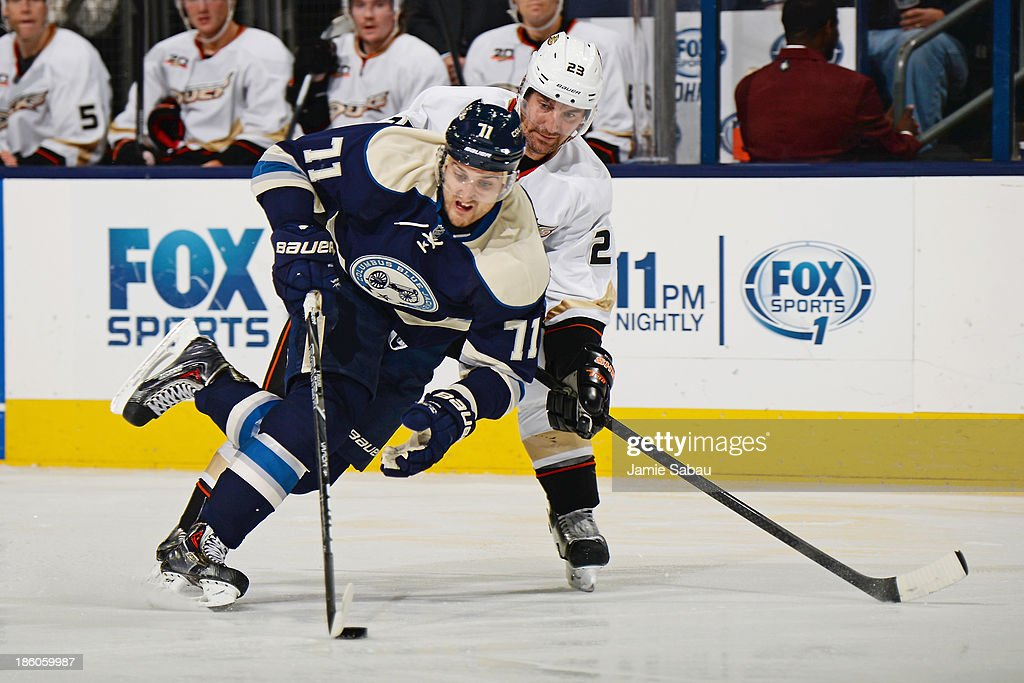Nick Foligno #71 of the Columbus Blue Jackets attempts to keep the puck from the defense of Francois Beauchemin #23 of the Anaheim Ducks during the third period on October 27, 2013 at Nationwide Arena in Columbus, Ohio. Anaheim defeated Columbus 4-3.