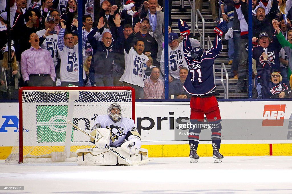 <a gi-track='captionPersonalityLinkClicked' href=/galleries/search?phrase=Nick+Foligno&family=editorial&specificpeople=537821 ng-click='$event.stopPropagation()'>Nick Foligno</a> #71 of the Columbus Blue Jackets celebrates after beating <a gi-track='captionPersonalityLinkClicked' href=/galleries/search?phrase=Marc-Andre+Fleury&family=editorial&specificpeople=233779 ng-click='$event.stopPropagation()'>Marc-Andre Fleury</a> #29 of the Pittsburgh Penguins for a goal during the third period of Game Six of the First Round of the 2014 NHL Stanley Cup Playoffs at Nationwide Arena on April 28, 2014 in Columbus, Ohio. Pittsburgh defeated Columbus 4-3 to win the series four games to two.