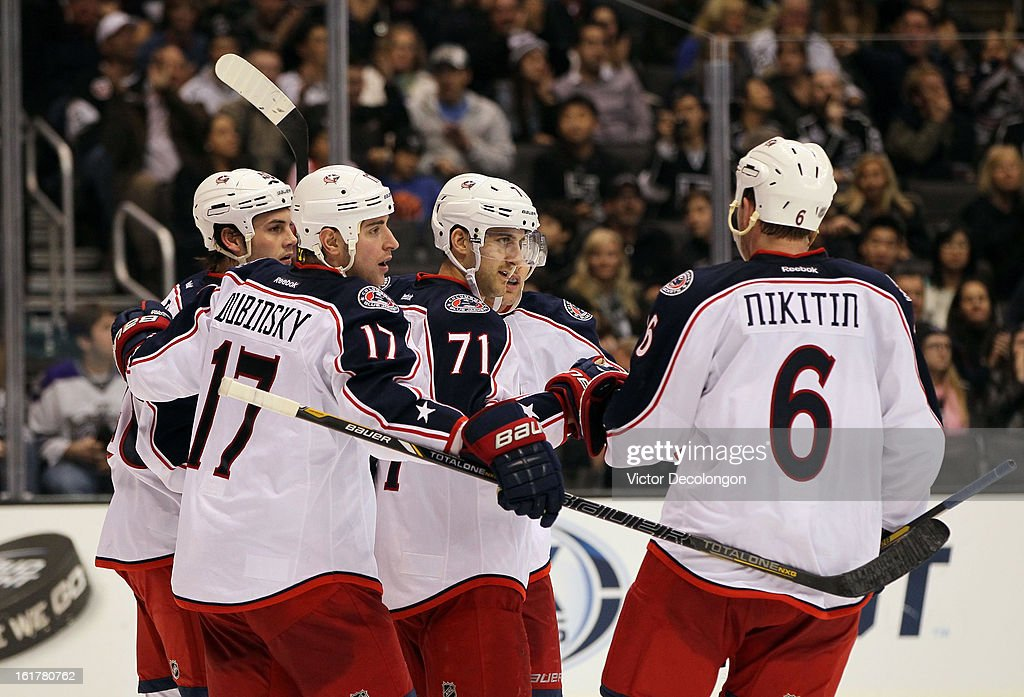 Nick Foligno #71 of the Columbus Blue Jackets celebrates after scoring a goal in the third period with teammates Jared Boll #40, Brandon Dubinsky #17, Jack Johnson #7 and Nikita Nikitin #6 during the NHL game against the Los Angeles Kings at Staples Center on February 15, 2013 in Los Angeles, California. The Kings defeated the Blue Jackets 2-1.
