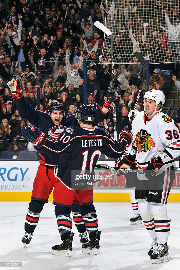 Nick Foligno #71 of the Columbus Blue Jackets celebrates with Mark Letestu #10 of the Columbus Blue Jackets after Letestu's first period goal against the Chicago Blackhawks on January 26, 2013 at Nationwide Arena in Columbus, Ohio.