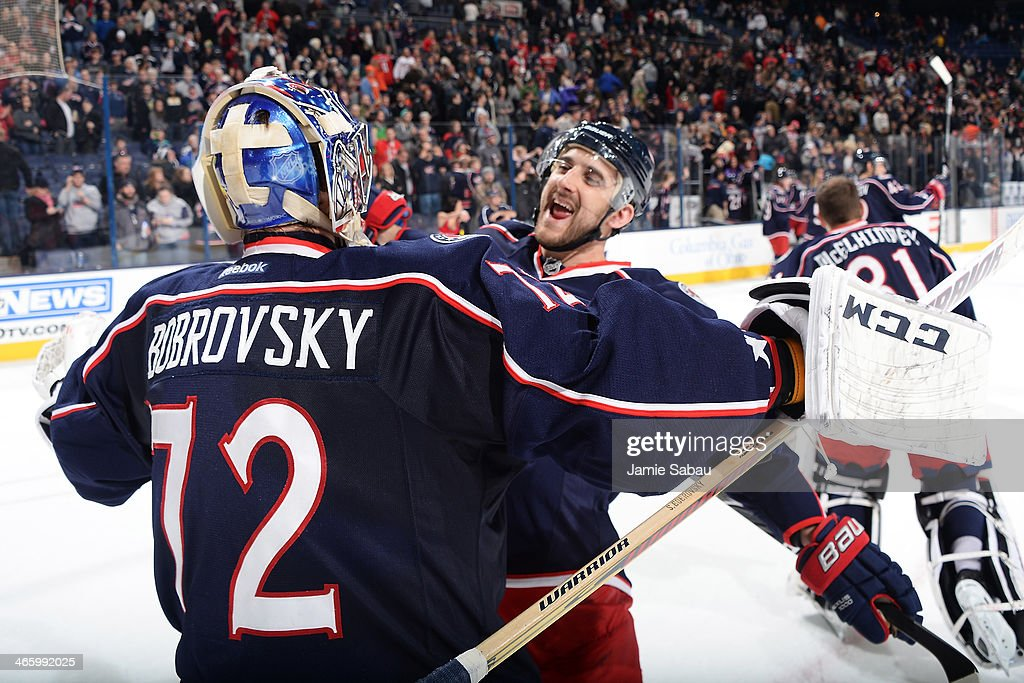 Nick Foligno of the Columbus Blue Jackets celebrates with Sergei Bobrovsky of the Columbus Blue Jackets after defeating the Washington Capitals 52 on...