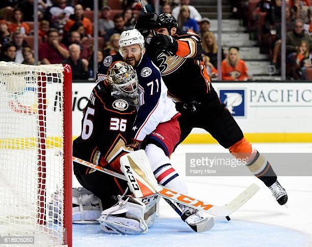 Nick Foligno of the Columbus Blue Jackets collides with John Gibson of the Anaheim Ducks as Kevin Bieksa of the Anaheim Ducks follows during the...