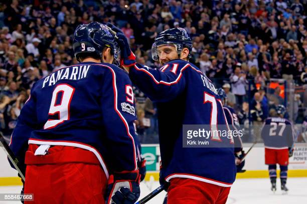 Nick Foligno of the Columbus Blue Jackets congratulates Artemi Panarin of the Columbus Blue Jacketson after assisting on a goal by Ryan Murray of the...