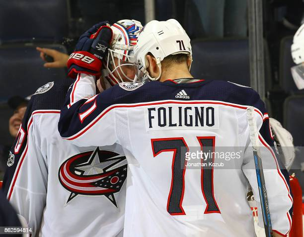 Nick Foligno of the Columbus Blue Jackets congratulates goaltender Joonas Korpisalo who backstopped the team to a 52 victory over the Winnipeg Jets...