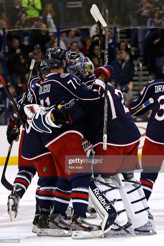 <a gi-track='captionPersonalityLinkClicked' href=/galleries/search?phrase=Nick+Foligno&family=editorial&specificpeople=537821 ng-click='$event.stopPropagation()'>Nick Foligno</a> #71 of the Columbus Blue Jackets congratulates <a gi-track='captionPersonalityLinkClicked' href=/galleries/search?phrase=Sergei+Bobrovsky&family=editorial&specificpeople=4488556 ng-click='$event.stopPropagation()'>Sergei Bobrovsky</a> #72 of the Columbus Blue Jackets after defeating the Colorado Avalanche 2-1 in overtime on March 3, 2013 at Nationwide Arena in Columbus, Ohio.