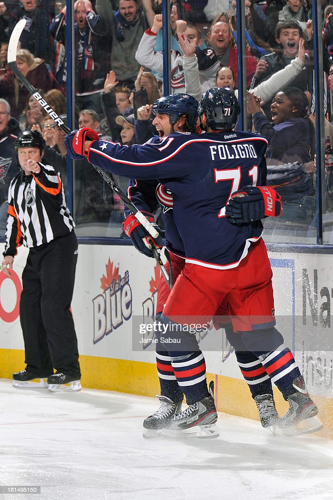 <a gi-track='captionPersonalityLinkClicked' href=/galleries/search?phrase=Nick+Foligno&family=editorial&specificpeople=537821 ng-click='$event.stopPropagation()'>Nick Foligno</a> #71 of the Columbus Blue Jackets congratulates Vinny Prospal #22 of the Columbus Blue Jackets on his third period goal against the San Jose Sharks on February 11, 2013 at Nationwide Arena in Columbus, Ohio. Columbus defeated San Jose 6-2.